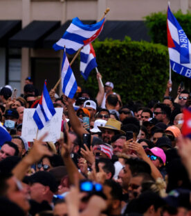 Emigres in Little Havana wave American and Cuban flags as they react to reports of protests in Cuba against the deteriorating economy, in Miami, Florida, U.S., July 11, 2021.   REUTERS/Maria Alejandra Cardona